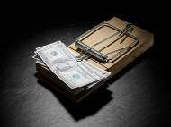 stock-photo-11294809-american-dollars-in-a-mousetrap